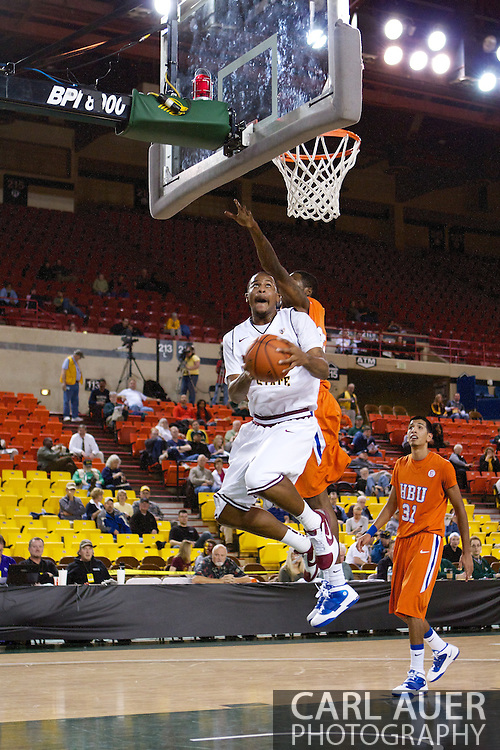 November 25th, 2010:  Anchorage, Alaska - Arizona State forward Kyle Cain (5) attempts a reverse lay up past the Houston Baptist defense in the Sun Devil victory over the Huskies, 73-55, at the Great Alaska Shootout.