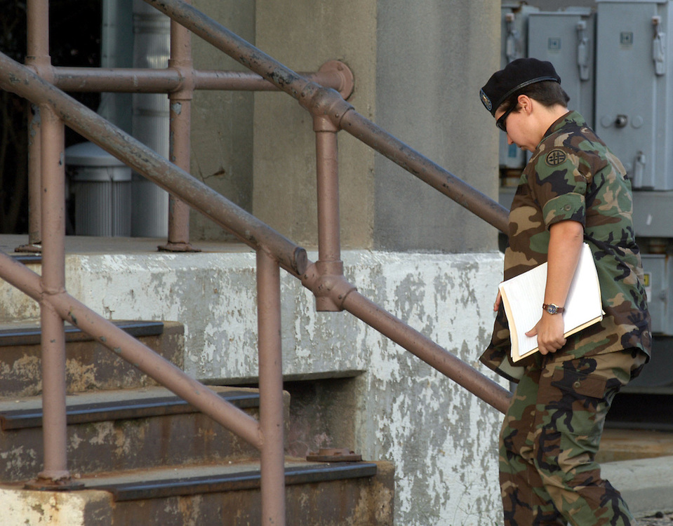 FORT BRAGG, NC- AUGUST 6: Pfc. Lynndie England arrives at the Staff Judge Advocate Building on Fort Bragg in Fayetteville, NC on 8/6/04 for her Article 32 investigation hearing. England is charged with several counts, including one specification of conspiring to commit maltreatment of an Iraqi detainee, three specifications of assault against Iraqis, and several others. (Photo by Logan Mock-Bunting)
