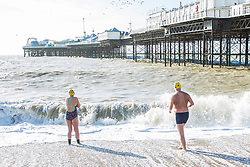 © Licensed to London News Pictures. 11/02/2018. Brighton, UK. Members of the Brighton Swimming Club brave the powerful waves and cold water to take a swim in the Brighton and Hove sea. Photo credit: Hugo Michiels/LNP