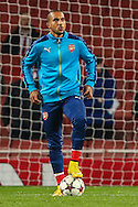 Theo Walcott of Arsenal warms up before the UEFA Champions League match at the Emirates Stadium, London<br /> Picture by David Horn/Focus Images Ltd +44 7545 970036<br /> 04/11/2014