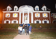EDITORS PLEASE NOTE: WE WERE ONLY ALLOWED TO IDENTIFY AND SHOW FACES ON THREE OF THE MONITORS AND NOT ALLOWED TO IDENTIFY FRATERNITIES BY NAME: Party goers arrive at a fraternity party as monitors check in on fraternities and sororities at Penn State University Sunday, November 12, 2017 in State College, Pennsylvania. (Photo by William Thomas Cain/CAIN IMAGES)