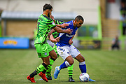 Oldham Athletic defender Alex Lacovitti holds off a challenge from Forest Green Rovers defender Dominic Bernard (3) during the EFL Sky Bet League 2 match between Forest Green Rovers and Oldham Athletic at the New Lawn, Forest Green, United Kingdom on 3 August 2019.