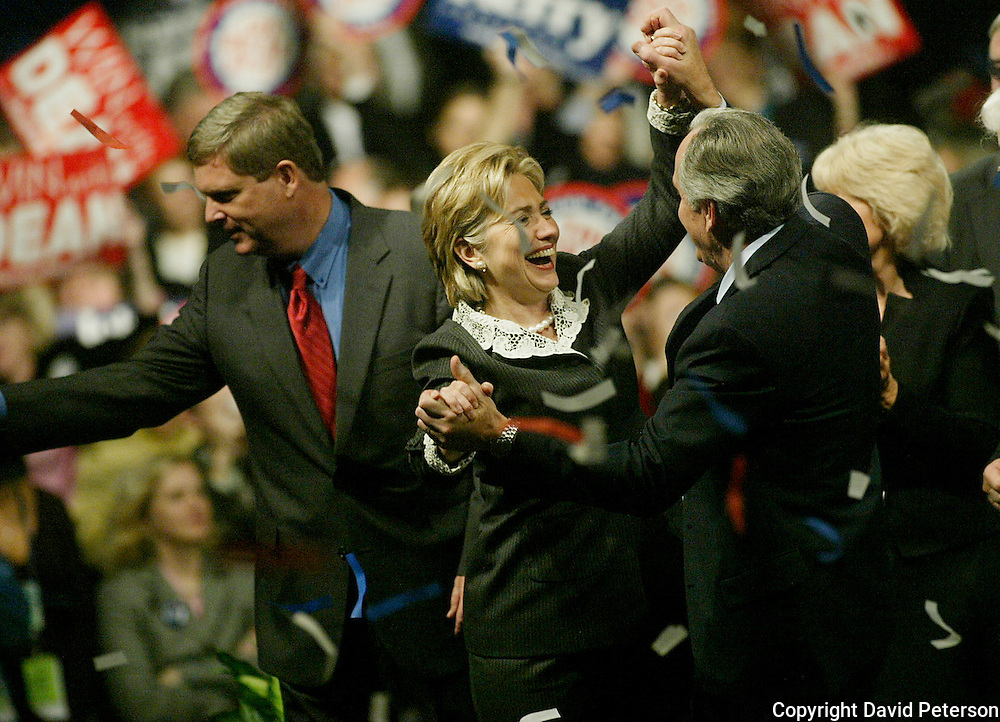 Presidential candidate Hillary Clinton dances with Iowa Senator Tom Harkin during the annual Jefferson/Jackson dinner in Des Moines Iowa in 2003.  At left is Iowa governor Tom Vilsack, who would launch his own short-lived presidential campaign in 2007.