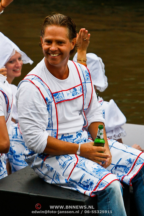 NLD/Amsterdam/20100807 - Boten tijdens de Canal Parade 2010 door de Amsterdamse grachten. De jaarlijkse boottocht sluit traditiegetrouw de Gay Pride af. Thema van de botenparade was dit jaar Celebrate, BNN boot, Danny de Munk