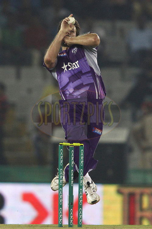 Ben Hilfenhaus of the Hobart Hurricanes sends down a delivery during match 2 of the Oppo Champions League Twenty20 between the Kings XI Punjab and the Hobart Hurricanes held at the Punjab Cricket Association Stadium, Mohali, India on the 18th September 2014<br /> <br /> Photo by:  Shaun Roy / Sportzpics/ CLT20<br /> <br /> <br /> Image use is subject to the terms and conditions as laid out by the BCCI/ CLT20.  The terms and conditions can be downloaded here:<br /> <br /> http://sportzpics.photoshelter.com/gallery/CLT20-Image-Terms-and-Conditions-2014/G0000IfNJn535VPU/C0000QhhKadWcjYs