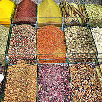 Spices, Nuts and Cinnamon Display at Spice Bazaar in Faith Municipality, Istanbul, Turkey<br /> This display of spices, nuts and cinnamon is typical of what you'll see at the Spice Bazaar in Istanbul, Turkey.  Located along the waterfront in the Faith municipality next to the famous Yeni Camii (the new mosque) and several other historical mosques, the Spice Bazaar is the second largest of the old covered markets and, as its name implies, it is the epicenter of the city's spice trade.  Its Turkish name is Misir Çarşisí.