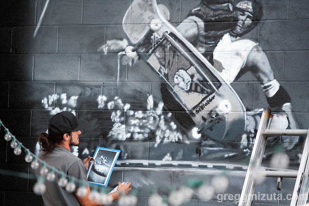 Sector Seventeen artist Solomon Hawk Sahlein &quot;Elms One&quot; paints a mural based on a J. Grant Brittain image of Neil Blender. Elms painted the mural during the Mics and Mini Ramps event on June 25, 2016 at The Shredder in Boise, Idaho. (Gregg Mizuta/greggmizuta.com)<br />