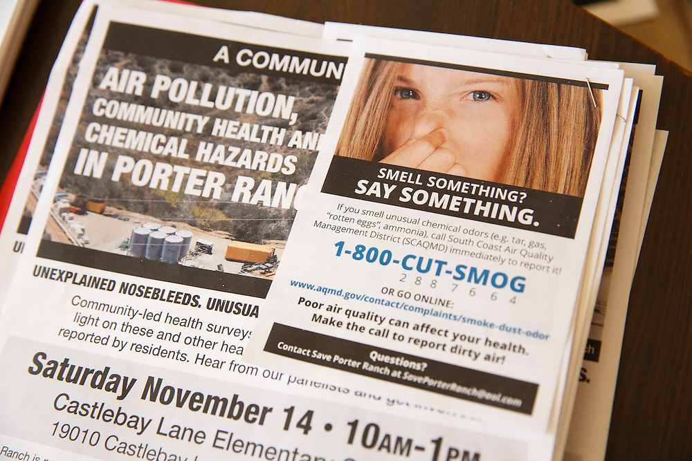 "A flyer for ""Smell Something? Say Something."" is seen at the home of co-founders of Save Porter Ranch Kyoko Hibino and Matt Pakucko, right, as methane gas leaks from the SoCalGas Aliso Canyon Storage Facility well SS-25 in the Porter Ranch neighborhood of Los Angeles, California on Wednesday, December 30, 2015. The Aliso Canyon gas leak (also called Porter Ranch gas leak) was a massive natural gas leak that started on October 23, 2015. According to Wikipedia, an estimated 1,000,000 barrels per day was released from a well within the underground storage facility in the Santa Susana Mountains near Porter Ranch. The second-largest gas storage facility it belongs to the Southern California Gas Company (SoCalGas), a subsidiary of Sempra Energy. On Jan. 6, 2016, Governor Jerry Brown issued a State of Emergency. The Aliso gas leak carbon footprint is said to be larger than the Deepwater Horizon leak in the Gulf of Mexico. On Feb. 11, 2016 the gas company reported that it had the leak under control. On Feb. 18 state officials announced that the leak was permanently plugged. An estimated 97,100 tonnes of methane and 7,300 tonnes of ethane was released into the atmosphere, making it the worst natural gas leak in U.S. history in terms of its environmental impact. © 2015 Patrick T. Fallon"