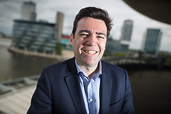 © Licensed to London News Pictures . 19/05/2016 . Salford , UK . Shadow Home Secretary ANDY BURNHAM MP poses for photos on a balcony after launching his campaign to be the Labour Party's candidate for Mayor of Greater Manchester , from The Compass Room at The Lowry Theatre in Salford . Photo credit : Joel Goodman/LNP