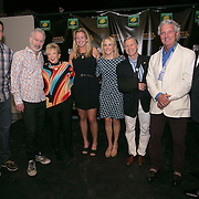 March 6, 2015, Indian Wells, California:<br /> Coco Vandeweghe, Tracy Austin, Andy Roddick, and John McEnroe pose for a photograph with guests during the McEnroe Challenge for Charity VIP Draw Ceremony in Stadium 2 at the Indian Wells Tennis Garden in Indian Wells, California Friday, March 6, 2015.<br /> (Photo by Billie Weiss/BNP Paribas Open)