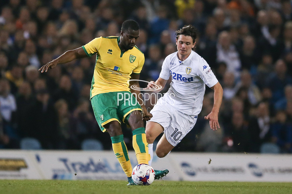 Norwich City defender Sebastien Bassong (6) is closed down by Leeds United forward Marcus Antonsson (10)  during the EFL Cup 4th round match between Leeds United and Norwich City at Elland Road, Leeds, England on 25 October 2016. Photo by Simon Davies.
