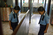 Usha (name changed), aged 10, prepares for school in her house in SOS Children's Villages Sanothimi, Bhaktapur, Nepal on 2 July 2015. Usha's entire family perished when her house collapsed in the earthquake on 25th April 2015. Usha is now well integrated into her new family and school. Photo by Suzanne Lee for SOS Children's Villages