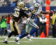 Dallas Cowboys wide receiver Dez Bryant (88) stiff arms New Orleans Saints free safety Isa Abdul-Quddus (42) at Cowboys Stadium in Arlington, Texas, on December 23, 2012.  (Stan Olszewski/The Dallas Morning News)