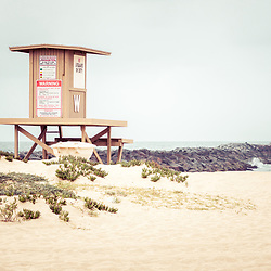 The Wedge Lifeguard Tower W and Newport Beach Jetty. The Wedge is a popular surf spot in Orange County Southern California in the United States of America. Copyright ⓒ 2010 Paul Velgos with All Rights Reserved.