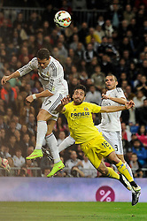 01.03.2015, Estadio Santiago Bernabeu, Madrid, ESP, Primera Division, Real Madrid vs FC Villarreal, 25. Runde, im Bild Real Madrid&acute;s Cristiano Ronaldo and Villarreal CF&acute;s Jaume Costa // during the Spanish Primera Division 25th round match between Real Madrid CF and Villarreal at the Estadio Santiago Bernabeu in Madrid, Spain on 2015/03/01. EXPA Pictures &copy; 2015, PhotoCredit: EXPA/ Alterphotos/ Luis Fernandez<br /> <br /> *****ATTENTION - OUT of ESP, SUI*****