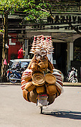 Bicycle laden with woven hats and baskets