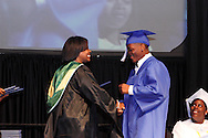 Principal Marlayna A. Randolph shakes hands with graduate Christopher Maddox during the Paul Laurence Dunbar High School commencement in the Dayton Convention Center in downtown Dayton, Wednesday, May 23, 2012.