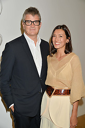 JAY JOPLING and HIKARI YOKOYAMA at a private view and auction of millinery organised by author, philanthropist and hat collector Eva Lanska in aid of Women for Women International held at Pace, Burlington Gardens, London on 10th June 2015.