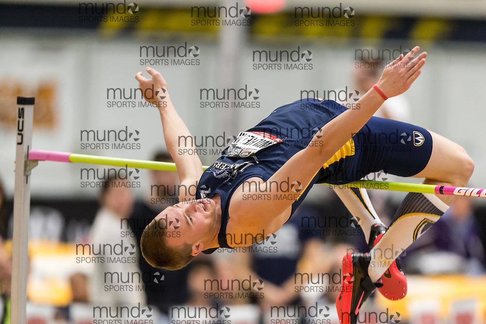 Windsor, Ontario ---2015-03-16--- Branden Wilhelm of Windsor  competes in the pentathlon high jump at the 2015 CIS Track and Field Championships in Windsor, Ontario, March 16, 2015.<br /> GEOFF ROBINS/ Mundo Sport Images