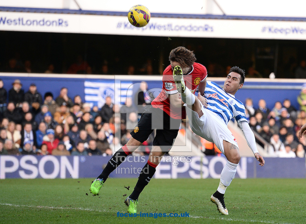 Eduardo Vargas of Queens Park Rangers and Daley Blind of Manchester United during the Barclays Premier League match at the Loftus Road Stadium, London<br /> Picture by Andrew Timms/Focus Images Ltd +44 7917 236526<br /> 17/01/2015