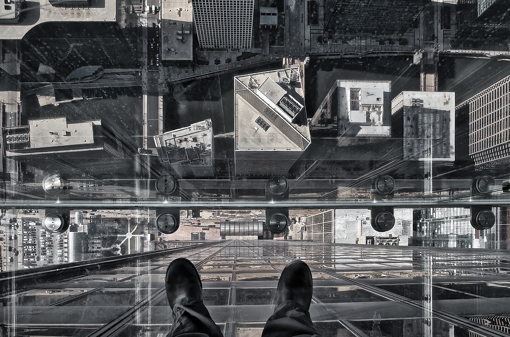 Vertigo!!! This photo was taken from one of the 3 glass boxes hanging on the side of the 103rd floor of the Sears/Willis Tower in Chicago. The tallest building in the western hemisphere and the third tallest in the world. At 1,353 feet (412m) in the air, <br />