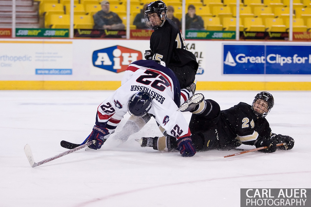 October 13, 2007 - Anchorage, Alaska: Sean Berkstresser (22) of the Robert Morris Colonials gets tripped up as he takes a shot in the 4-1 victory over the Wayne State Warriors at the Nye Frontier Classic at the Sullivan Arena.