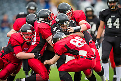 Kent Exiles running gets tackled - Mandatory by-line: Jason Brown/JMP - 27/08/2016 - AMERICAN FOOTBALL - Sixways Stadium - Worcester, England - Kent Exiles v East Kilbride Pirates - BAFA Britbowl Finals Day