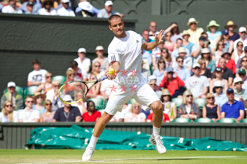 LONDON, ENGLAND - Monday, July 1, 2013: Mikhail Youzhny (RUS) during the Gentlemen's Singles 4th Round match on day seven of the Wimbledon Lawn Tennis Championships at the All England Lawn Tennis and Croquet Club. (Pic by David Rawcliffe/Propaganda)