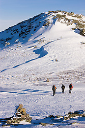 Winter hikers ascend Mount Clay in New Hampshire's White Mountains.  Winter. Northern Presidential mountain range.  Gulfside Trail.