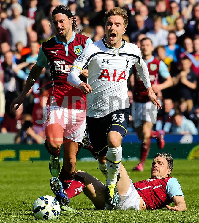 Tottenham Hotspur's Christian Eriksen avoids a tackle from Burnley's Sam Vokes - Photo mandatory by-line: Matt McNulty/JMP - Mobile: 07966 386802 - 05/04/2015 - SPORT - Football - Burnley - Turf Moor - Burnley v Tottenham Hotspur - Barclays Premier League