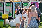 Queueing for the composting toilets - The 2019 Glastonbury Festival, Worthy Farm. Glastonbury, 27 June 2019