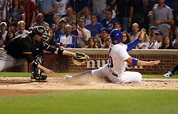 August 30, 2017 - Chicago, IL, USA - The Chicago Cubs' Jon Jay (30) scores on a single by Ian Happ during the first inning, beating the tag from Pittsburgh Pirates catcher Chris Stewart at Wrigley Field in Chicago on Wednesday, Aug. 30, 2017. (Credit Image: © Nuccio Dinuzzo/TNS via ZUMA Wire)