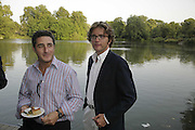 Luca del Bona and Guilio Salamone. Fiat Pandamonium launch , Stephen Bayley and  Guilio Salamone MD of Fiat launch new amphibious car,  Fiat Amphibia.The Boathouse, Battersea Park Lake, London, 20 July 2006.<br />