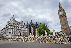 © Licensed to London News Pictures. 19/06/2012. LONDON, UK. Members of the British Army's 20 Armoured Brigade parade through Westminster as they march to the Houses of Parliament for a reception with MPs following their return from Afghanistan. Photo credit: Matt Cetti-Roberts/LNP