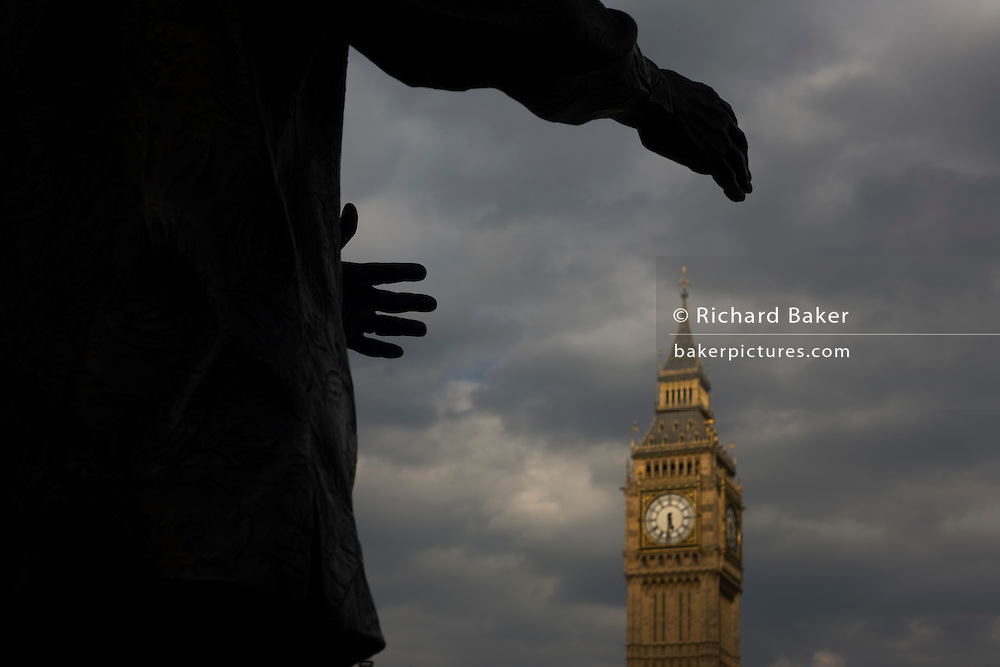 A symbolic grasp for British political power. The reaching hands of ex-South African President Nelson Mandela's statue seemingly grasp the Big Ben clock tower in Parliament Square, Westminster, central London. On the day of the British general election where a hung parliament is a possibility, the fight for power of the nation appears to be an historic possibility.