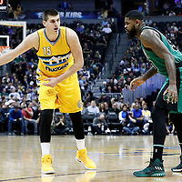 10 March 2017: Denver Nuggets forward Nikola Jokic (15) passes the ball around Boston Celtics forward Amir Johnson (90) during the Denver Nuggets 119-99 victory over the Boston Celtics, at the Pepsi Center, Denver, Colorado, USA.