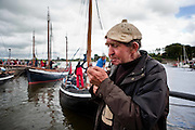"Paddy Dundass,Kilkeerin,Connemara takes a break after unloading the turf from ""Capall"" the oldest boat taking part in the Crinniú na mBad,Kinvara,Co Galway at the weekend. Photograph by Eamon Ward"