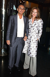 TRINNY WOODALL and her husband JONNY ELICHAOFF  at Tatler Magazine's Summer Party held at the Baglioni Hotel, 60 Hyde Park Gate, London SW7 on 1st July 2004.