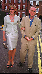 MR & MRS SIMON SEBAG-MONTEFIORE, she is a family friend of the Prince of Wales, at a party in London on 30th June 1999.MTY 123