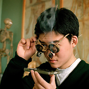 The smoke from the burning herb balls filters through the walnut shells and cures eye ailment...Photo taken March 2000