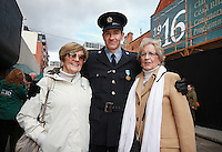 Garda Mark Massey, who is stationed at Knock Airport pictured with sisters Roisin O Rahilly  and Iseult Broglio [ Nee O Rahilly] now living in the US , after the Wreath Laying ceremony on Dublins Moore Street. Garda Mark Massey's father Edward Dunphy was a Dublin Metropolitan Policeman in the GPO during the Rising  and was let go by Michael O Rahilly [ Iseult and Roisin's father] after the rebels took over the GPO. Picture Credit Frank Mc Grath<br /> 28/3/16