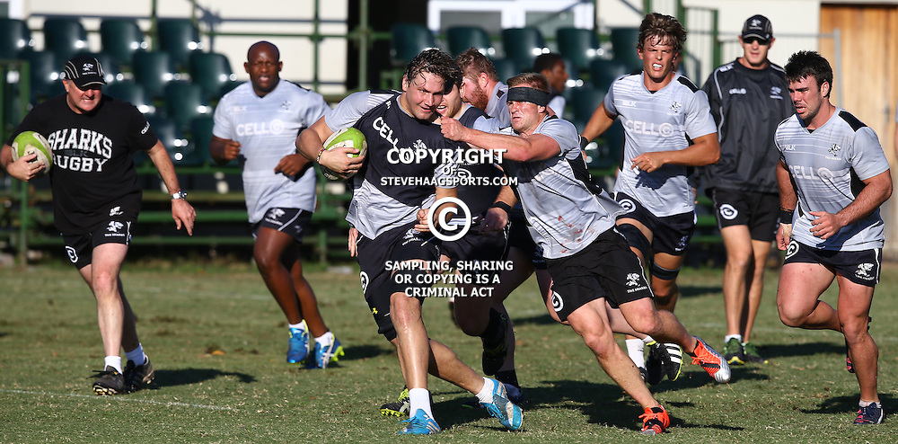 DURBAN, SOUTH AFRICA - JULY 27: Michael Claassens tackling Etienne Oosthuizen during the Cell C Sharks training session at Growthpoint Kings Park on July 27, 2015 in Durban, South Africa. (Photo by Steve Haag)