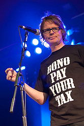 "© licensed to London News Pictures. Glastonbury Festival, UK. Chumbawamba play on The Avalon Stage, Glastonbury Festival. The entire band wer Tshifts that say ""Bono pay your tax"" Please see special instructions for usage rates. Photo credit should read David Mirzoerff/LNP"