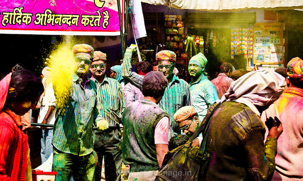People greet each other with colors at a market place in Barsana, Mathura. Braj ki Holi
