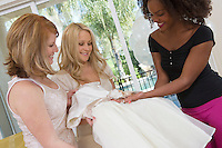Bride Showing Off her Wedding Dress at Bridal Shower