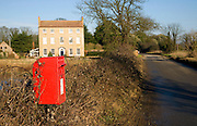 Red post box and Georgian farmhouse, Bawdsey, Suffolk, England