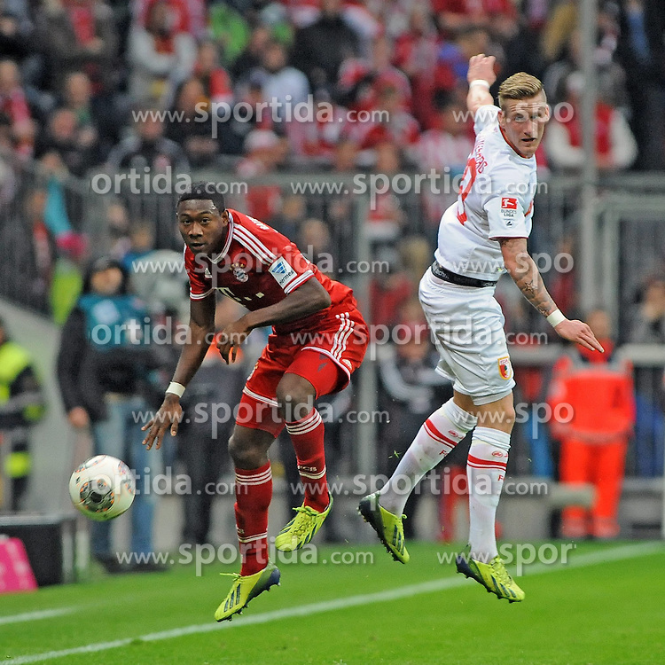 09.11.2013, Allianz Arena, Muenchen, GER, 1. FBL, FC Bayern Muenchen vs FC Augsburg, 12. Runde, im Bild Rechts Andre Hahn (FC Augsburg) im Zweikampf, Aktion, Kopfballduell mit David Alaba (FC Bayern Muenchen), links // during the German Bundesliga 12th round match between FC Bayern Munich and FC Augsburg at the Allianz Arena in Muenchen, Germany on 2013/11/09. EXPA Pictures &copy; 2013, PhotoCredit: EXPA/ Eibner-Pressefoto/ Stuetzle<br /> <br /> *****ATTENTION - OUT of GER*****