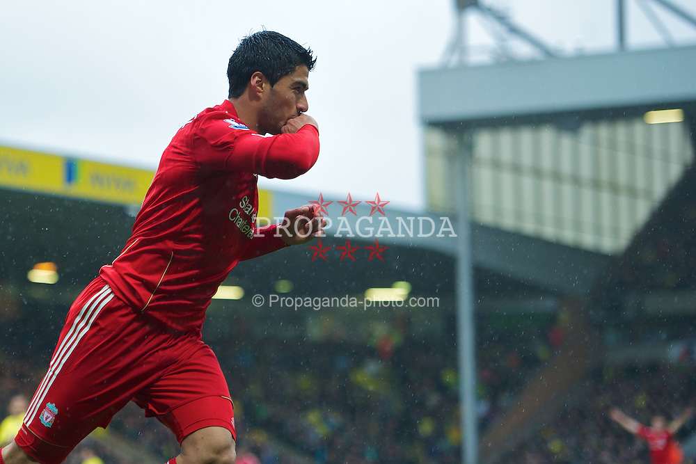 NORWICH, ENGLAND - Saturday, April 28, 2012: Liverpool's Luis Alberto Suarez Diaz celebrates scoring the first goal of his hat-trick against Norwich City during the Premiership match at Carrow Road. (Pic by David Rawcliffe/Propaganda)
