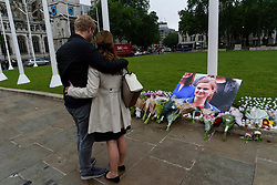 © Licensed to London News Pictures. 17/06/2016. Well wishers and tributes in Parliament Square in memory of Labour party MP JO COX.  She was allegedly attacked and killed by suspect 52 year old Tommy Mair close to Birstall Library near Leeds.  London, UK. Photo credit: Ray Tang/LNP