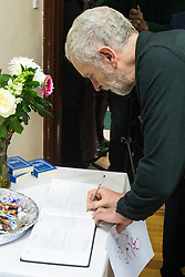 Finsbury Park Mosque, London, February 7th 2016. Labour Leader and local MP Jeremy Corbyn signs the visitor' book at Finsbury Park Mosque which he visited as part of a Visit My Mosque initiative by the Muslim Council of Britain to show non-Muslims &ldquo;how Muslims connect to God, connect to communities and to neighbours around them&rdquo;.<br /> . ///FOR LICENCING CONTACT: paul@pauldaveycreative.co.uk TEL:+44 (0) 7966 016 296 or +44 (0) 20 8969 6875. &copy;2015 Paul R Davey. All rights reserved.